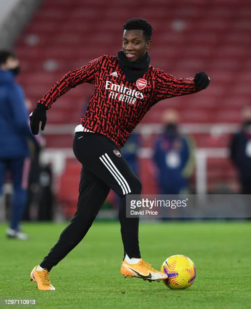 Eddie Nketiah of Arsenal warms up before the Premier League match between Arsenal and Newcastle United at Emirates Stadium on January 18, 2021 in...