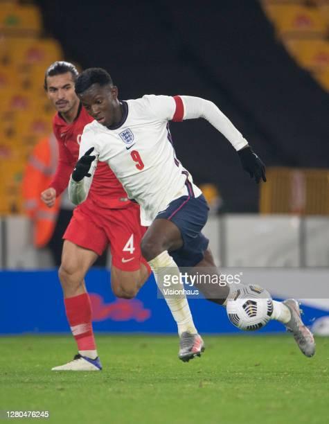 Eddie Nketiah of England and Hüseyin Türkmen of Turkey during the UEFA Euro Under 21 Qualifier match between England U21 and Turkey U21 at Molineux...