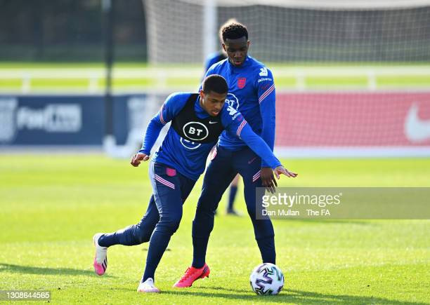 Eddie Nketiah of England and Rhian Brewster challenge for the ball during the England U21 Training Session at St George's Park on March 22, 2021 in...