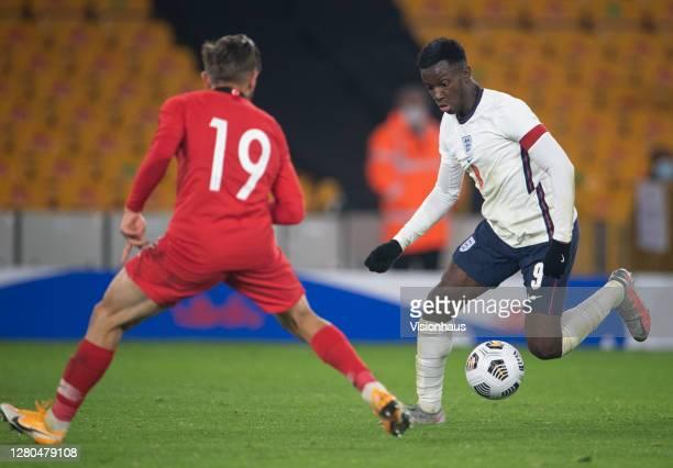 Eddie Nketiah of England and Serkan Asan of Turkey during the UEFA Euro Under 21 Qualifier match between England U21 and Turkey U21 at Molineux on...