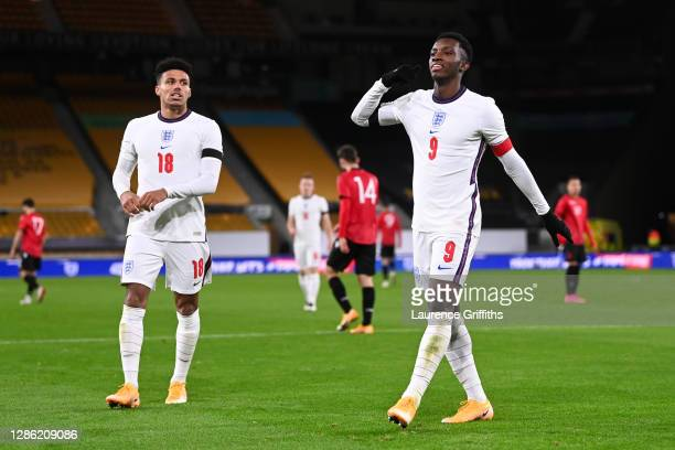 Eddie Nketiah of England celebrates with teammate James Justin after scoring their team's fourth goal during the UEFA Euro Under 21 Qualifier match...