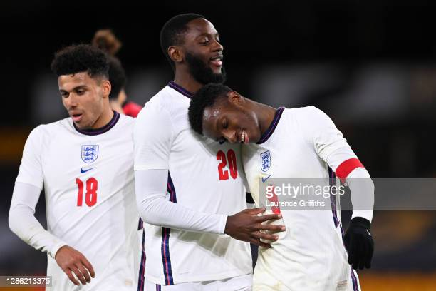 Eddie Nketiah of England celebrates with teammates Josh Dasilva and James Justin after scoring their team's fifth goal during the UEFA Euro Under 21...