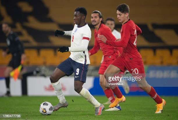 Eddie Nketiah of England goas past Ravil Tagr of turkey before scoring the goal that makes him England's highest goalscorer at U21 level during the...