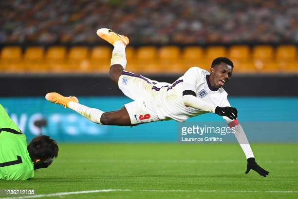 Eddie Nketiah of England is brought down in the area by Marco Molla of Albania which leads to a penalty awarded to England during the UEFA Euro Under...