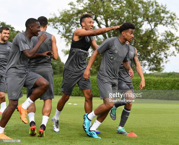 Eddie Nketiah PierreEmerick Aubameyang and Reiss Nelson of Arsenal during a training session at London Colney on July 16 2018 in St Albans England