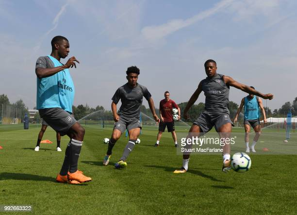 Eddie Nketiah Reiss Nelson and Chuba AKpom of Arsenal during a training session at London Colney on July 6 2018 in St Albans England