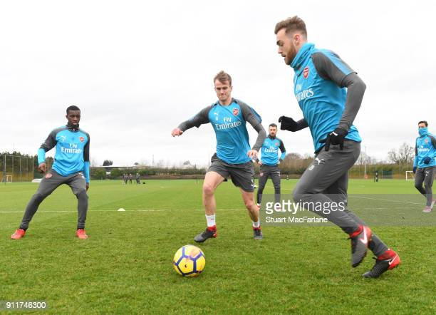 Eddie Nketiah Rob Holding and Calum Chambers of Arsenal during a training session at London Colney on January 29 2018 in St Albans England