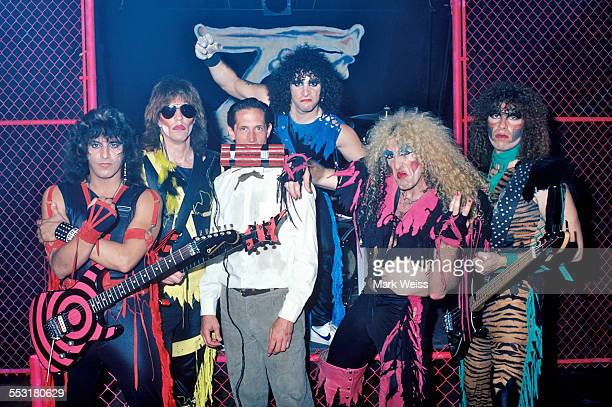 Eddie Ojeda Jay Jay French AJ Pero Dee Snider and Mark Mendoza of Twisted Sister with actor Mark Metcalf on set during the video shoot for 'I Wanna...