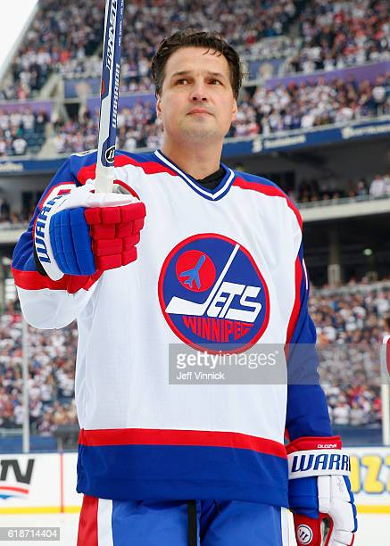 Eddie Olczyk of the Winnipeg Jets alumni team waves to the crowd during team introductions for the 2016 Tim Hortons NHL Heritage Classic Alumni Game...