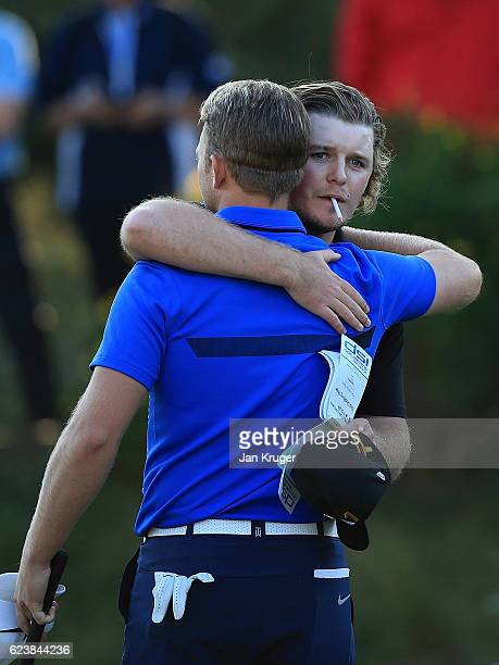 Eddie Pepperell and Tom Lewis of England embrace after securing their European Tour cards during the final round of the European Tour qualifying...
