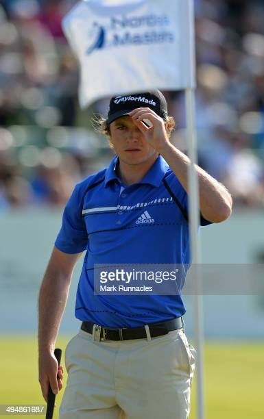 Eddie Pepperell of England acknowledges the applause from the gallery around the 18th green during the Nordea Masters at the PGA Sweden National on...