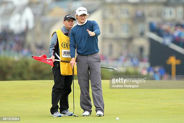 Eddie Pepperell of England and caddie Jamie Herbert line up a putt on the 16th green during the third round of the 144th Open Championship at The Old...