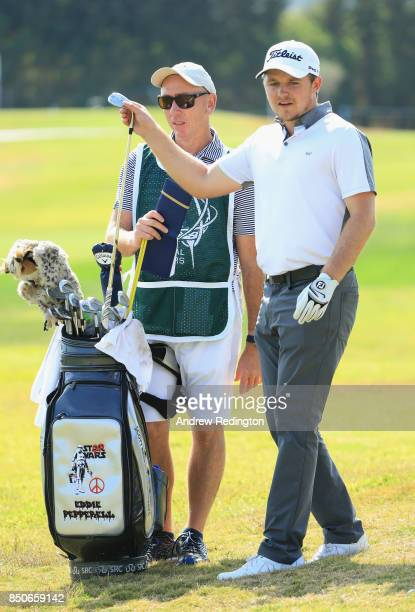 Eddie Pepperell of England and Caddie Nick Doran walk down the 2nd fairway during day one of the 2017 Portugal Masters at Oceanico Victoria Golf Club...