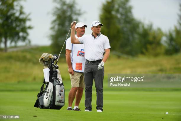 Eddie Pepperell of England and his caddie look along the 18th hole fairway during day one of the DD REAL Czech Masters at Albatross Golf Resort on...