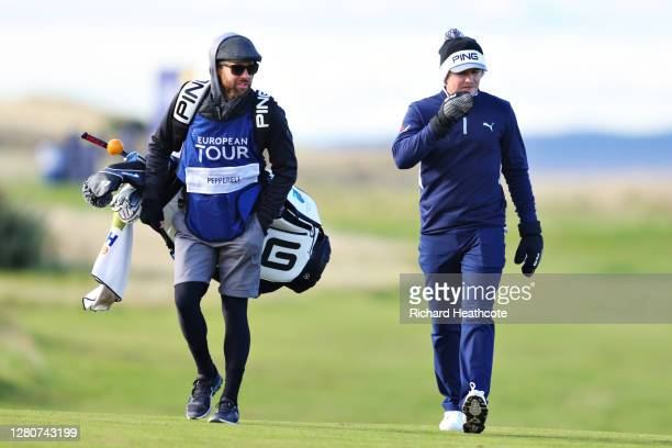 Eddie Pepperell of England and his caddie walk on the 12th fairway during Day Three of the Scottish Championship presented by AXA at Fairmont St...