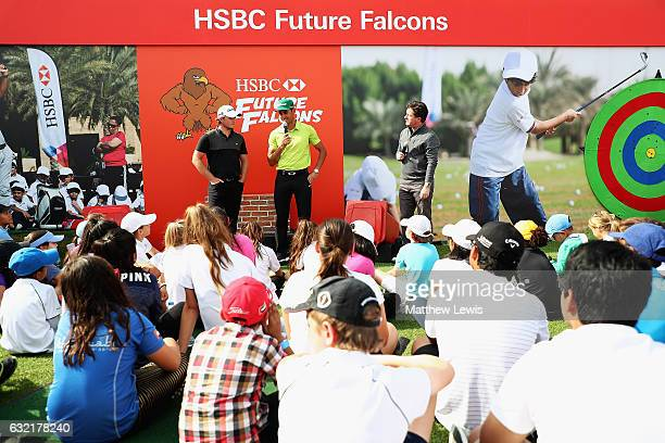 Eddie Pepperell of England and Rafa CabreraBello of Spain talk to the 'HSBC Future Falcons' during day two of the Abu Dhabi HSBC Championship at Abu...