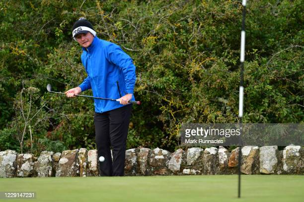 Eddie Pepperell of England hits a shot from a tricky lie by the wall on the 17th hole during Day Four of the Scottish Championship presented by AXA...