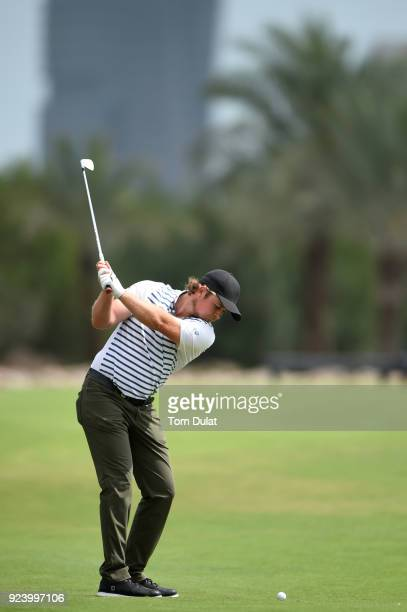 Eddie Pepperell of England hits an approach shot on the 15th hole during the final round of the Commercial Bank Qatar Masters at Doha Golf Club on...