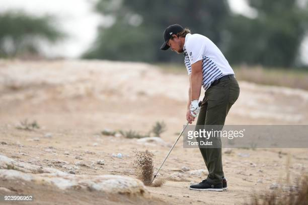 Eddie Pepperell of England hits from the rough on the 15th hole during the final round of the Commercial Bank Qatar Masters at Doha Golf Club on...