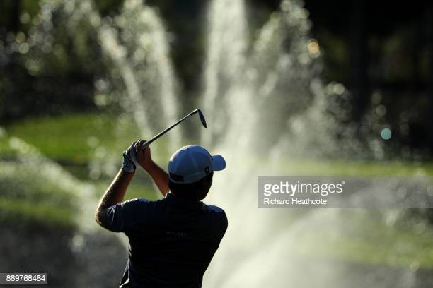 Eddie Pepperell of England hits his second shot on the 18th hole during the second round of the Turkish Airlines Open at the Regnum Carya Golf Spa...