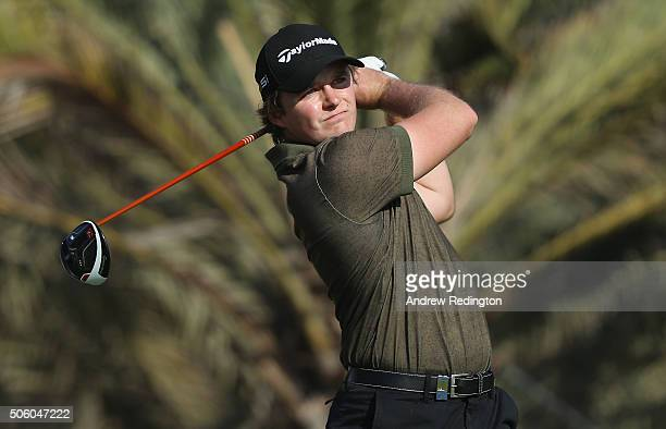 Eddie Pepperell of England hits his teeshot on the 14th hole during the first round of the Abu Dhabi HSBC Golf Championship at the Abu Dhabi Golf...