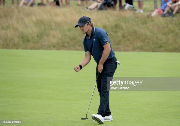 Eddie Pepperell of England holes a putt for birdie on the 17th hole during the final round of the 147th Open Championship at Carnoustie Golf Club on...