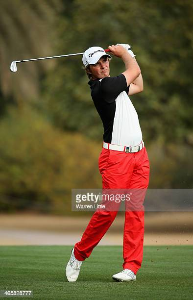 Eddie Pepperell of England in action during the first round of the 2014 Omega Dersert Classic on the Majlis Course at the Emirates Golf Club on...