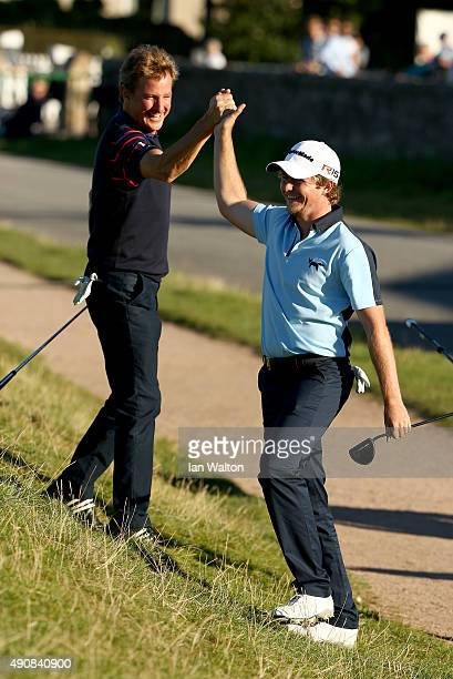 Eddie Pepperell of England is congratulated by Mark Nicholas after chipping in on the 17th green during the first round of the 2015 Alfred Dunhill...