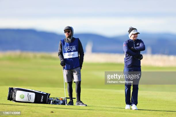 Eddie Pepperell of England looks on as his caddie drops his bag on the 14th fairway during Day Three of the Scottish Championship presented by AXA at...