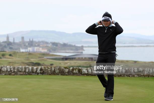 Eddie Pepperell of England looks on on the 16th green as St Andrews is seen in the background during Day Two of the Scottish Championship presented...