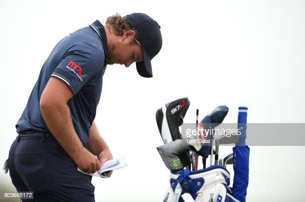 Eddie Pepperell of England marks his card during the third round of the Commercial Bank Qatar Masters at Doha Golf Club on February 24 2018 in Doha...