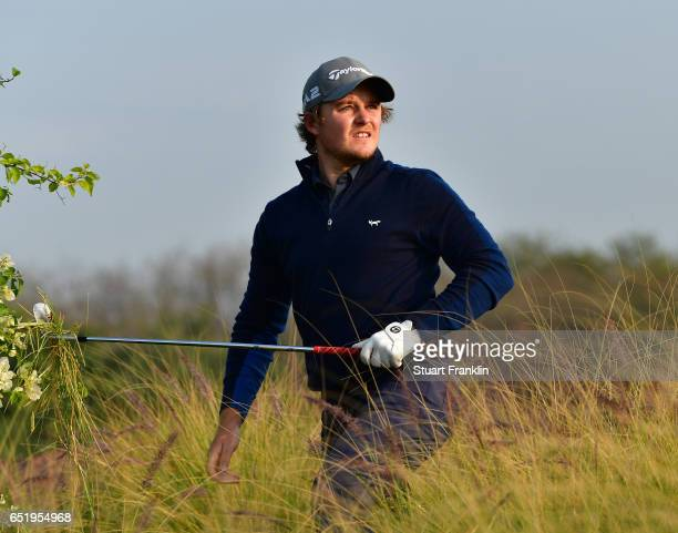 Eddie Pepperell of England plays a shot during the continuation of the second round round of the Hero Indian Open at Dlf Golf and Country Club on...