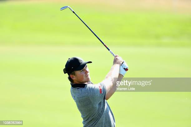 Eddie Pepperell of England plays his second shot on hole one during Day Four of the Portugal Masters at Dom Pedro Victoria Golf Course on September...