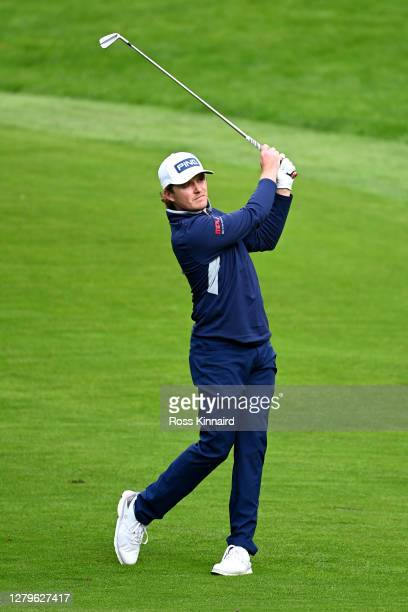 Eddie Pepperell of England plays his second shot on the 4th hole during Day Four of the BMW PGA Championship at Wentworth Golf Club on October 11...