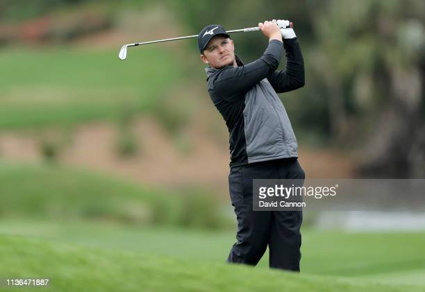 Eddie Pepperell of England plays his second shot on the par 4 14th hole during the final round of The Players Championship on the Stadium Course at...