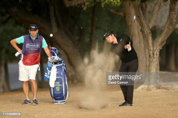 Eddie Pepperell of England plays his second shot on the par 5 10th hole during the second round of the Omega Dubai Desert Classic on the Majlis...