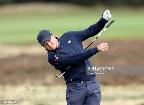 Eddie Pepperell of England plays his second shot on the second hole from the deep heather which caused him to let go of his club during the second...