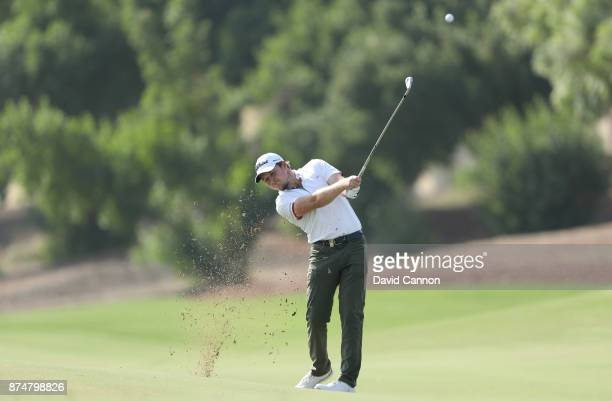 Eddie Pepperell of England plays his second shot on the third hole during the first round of the DP World Tour Championship on the Earth Course at...
