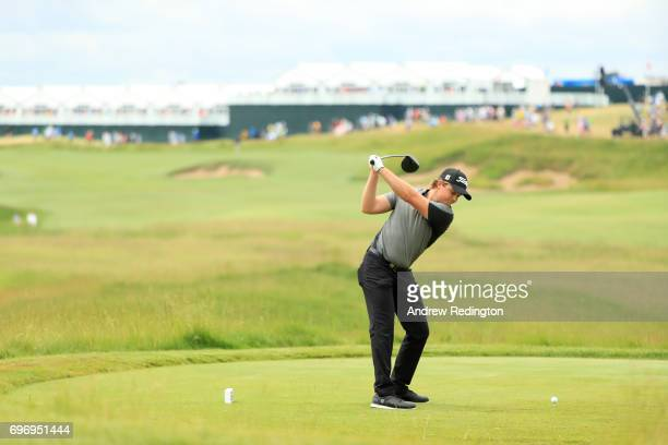 Eddie Pepperell of England plays his shot from the first tee during the third round of the 2017 US Open at Erin Hills on June 17 2017 in Hartford...