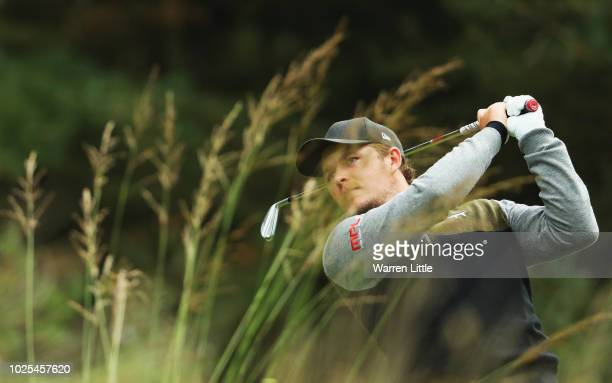 Eddie Pepperell of England plays his shot off the 16th tee during day two of the Made in Denmark played at the Silkeborg Ry Golf Club on August 31...