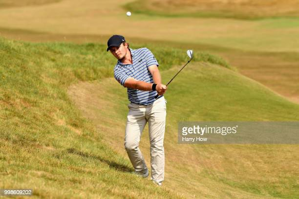 Eddie Pepperell of England plays out of the rough on hole one during day three of the Aberdeen Standard Investments Scottish Open at Gullane Golf...