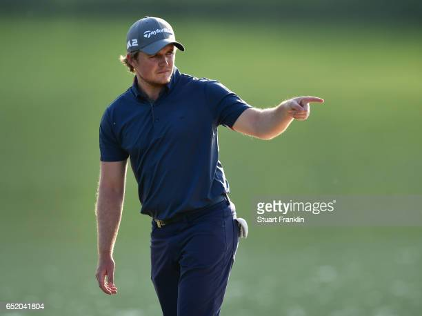 Eddie Pepperell of England points during the third round of the Hero Indian Open at Dlf Golf and Country Club on March 11 2017 in New Delhi India
