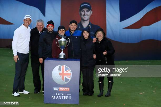 Eddie Pepperell of England pose for a photo with friends family and host Justin Rose of England after winning the tournament during day four of Sky...