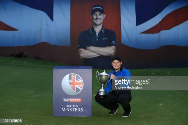 Eddie Pepperell of England pose for a photo with the trophy after winning the tournament during day four of Sky Sports British Masters at Walton...