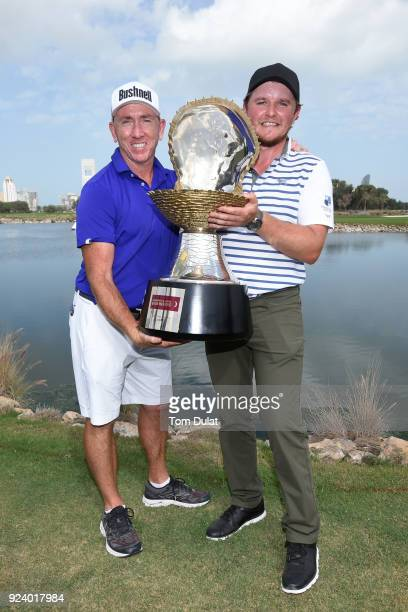 Eddie Pepperell of England poses with the trophy and caddie Mick Doran after his victory during the final round of the Commercial Bank Qatar Masters...