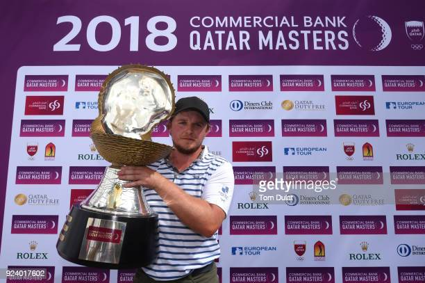 Eddie Pepperell of England poses with the trophy following his victory during the final round of the Commercial Bank Qatar Masters at Doha Golf Club...