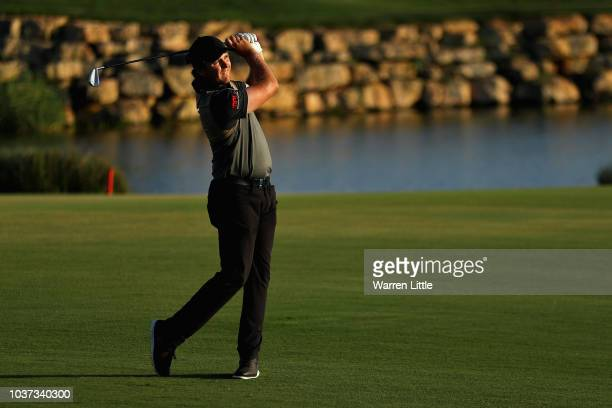 Eddie Pepperell of England takes his second shot on hole eighteen during Day Two of the Portugal Masters at Dom Pedro Victoria Golf Course on...