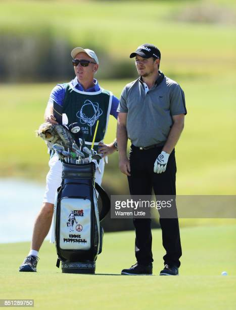 Eddie Pepperell of England talks with his caddie Nick Doran on the 17th hole during day two of the Portugal Masters at Dom Pedro Victoria Golf Club...