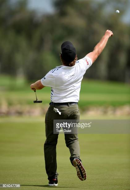 Eddie Pepperell of England throws his ball into the water following his victory during the final round of the Commercial Bank Qatar Masters at Doha...