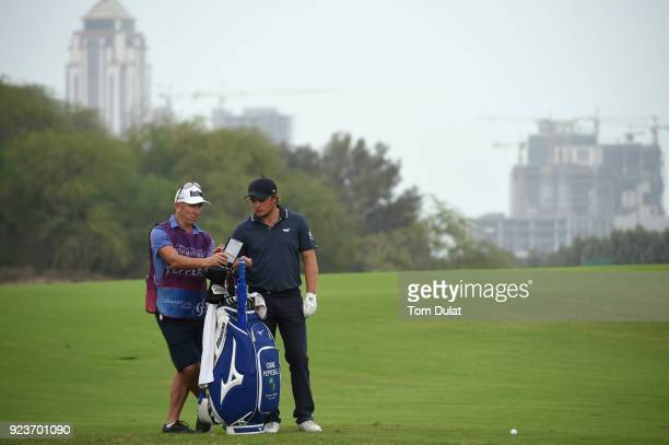Eddie Pepperell of England waits on the 18th hole with his caddie during the third round of the Commercial Bank Qatar Masters at Doha Golf Club on...
